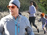 Matthew McConaughey leads the way as young son and daughter join him for a jog with wife Camila