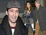 Matthew Morrison cuddles up to fiancee Renee Puente as they jet home from romantic holiday in Italy