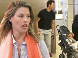 Back to real life! Make-up free Ali Larter pushes her son Teddy in his stroller as they jet home from tropical holiday