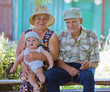grandmother and  grandfather with  grandson