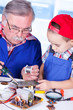 Grandfather showing PCB soldering to grandchild