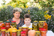 grandmother with her grandson and home canned vegetables
