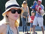 Play time! Naomi Watts and Liev Schreiber horse around with their kids in a Brentwood park Sunday
