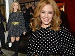 Kylie Minogue sexes up her pretty polka dot dress with thigh-high boots for Dolce and Gabbana's London Collections party