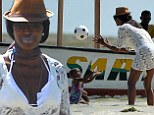 Play ball! Supermodel Naomi Campbell spends the day frolicking on the beach with a group of orphans while on a charitable mission in Kenya