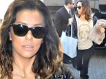 From fab to drab! Eva Longoria ditches her usual designer duds and sleek tresses for a decidedly dowdy look as she hotfoots it through LAX