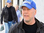 He's still got it! Bruce Willis draws gasps as he strolls around Beverly Hills after meeting friend for lunch