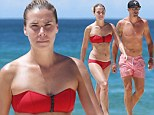 Bowled over by their buff bodies! England cricketer Kevin Pietersen washes away his Ashes blues as he hits Bondi beach with bikini clad Liberty X star wife Jessica Taylor