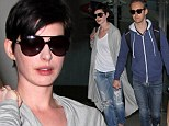 Up, up and Hath-away! Anne jets out of LA in ripped jeans and baggy cardie with husband Adam in tow