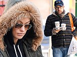 Pregnant Olivia Wilde treads carefully as she goes for a walk in the snow to grab warm beverage with fiance Jason Sudeikis