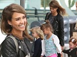 Jessica Alba beams from ear-to-ear as she and her family head home after an enjoyable sun-drenched Mexican holiday