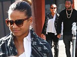 Rarely seen together, Christina Milian and fiance Jas Prince hold hands on their way to lunch in similar leather outfits