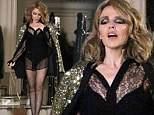 Roc chick! Kylie Minogue wears a black leotard, sheer shirt and not much else as she shoots her new video