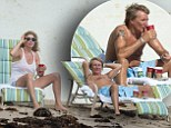 Forever young? Rod seemed to be struggling to keep up with his young family as he washed down pain killers with coffee during beach break in Florida