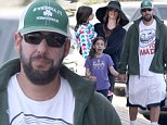 Teenager at heart: Adam Sandler wore a silly shirt for a day out with his daughters (pictured: Sadie) in Malibu on Saturday