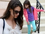 Making the most of the day: Katie Holmes took her daughter Suri to a movie on a gloomy day in Miami, Florida Saturday