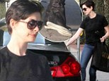 Nice outfit, pity about the shoes! Anne Hathaway ruins casual chic look with unsightly footwear on shopping trip in LA