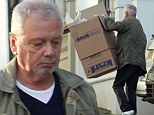 Thanks Dad! Posh's father moves boxes into the new Beckingham Palace... as Victoria and David enjoy family holiday in the Maldives