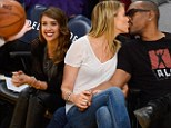 Courtside fun: Eddie Murphy smooches with his girlfriend while Jessica Alba giggles with a friend at the Los Angeles Laker¿s home game Sunday