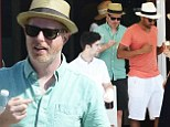 Sweet treats: Jesse Tyler Ferguson and his husband Justin Mikita picked up frozen desserts on Friday while vacationing in the Caribbean