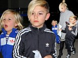 Kingston and Zuma Rossdale show off their street cred in sporty tracksuits and fun footwear at LAX with mom Gwen Stefani