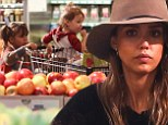 Mother's little helper! Jessica Alba's daughter Honor sweetly pushes her sister Haven around in a shopping trolley