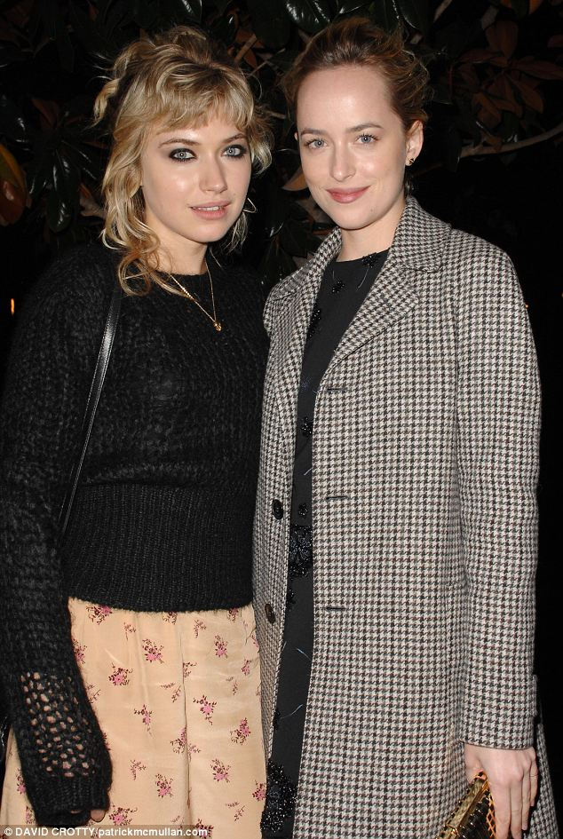 Check mate: Imogen Poots and Dakota Johnson pose together at the party