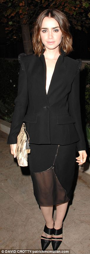 Chic: Lily goes for a simple black outfit while Rosie Huntington-Whiteley opts for white
