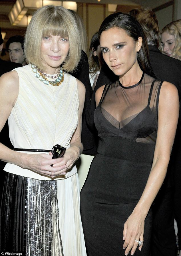 Elegance: Victoria (pictured with Anna Wintour)  looked serene with her hair worn loose and sleek