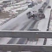 A screen capture shows the moment of impact during one of a series of accidents on I-25 Saturday, January 4, 2014.