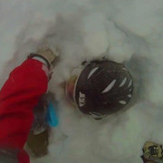 A video screen capture shows Edwin LaMair buried in snow following an avalanche near Vail on Sunday, December 22, 2013.