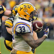 LSU Jeremy Hill runs the ball for the Tigers