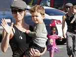 Fitness trainer Jillian Michaels shows off her biceps during a family stroll in Malibu Sunday