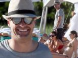 Hey ladies! Ryan Seacrest continues checking out the bikini-clad beauties while on vacation in Anguilla