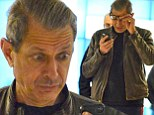 Not so smart phone? Jeff Goldblum pulls some hilarious facial expressions as he does battle with his mobile