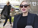 Pregnant Gwen Stefani vamps it up with red lipstick and killer heels as she stops by an acupuncture clinic in LA