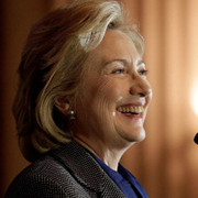 Hillary Clinton beams at audience response to her.