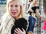 Something to bark about: Tori Spelling finds comfort in new puppy as she continues to keep mum on allegations husband cheated