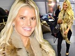 Making an entrance! Jessica Simpson turns the airport arrivals lounge into a fashion show in tight leather pants