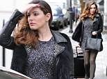 Kelly Brook leaves home with suitcase looking chic in purple leopard print dress and furry leather jacket
