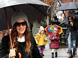 Kaleidoscopic kids! Sarah Jessica Parker's delightful twins bring some colour to the stormy New York streets