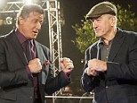 Come at me! Sylvester Stallone, left, and Robert De Niro, right, jokingly pumped fists as they promoted the premiere of their film Grudge Match in Rome, Italy on Tuesday