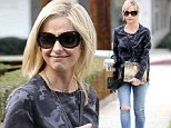 Sarah Michelle Gellar shows off glossy blonde locks after getting her roots done at salon