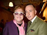 Elton John and David Furnish at the Savile Row fashion show
