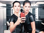 Mirror image! Victoria's Secret Angels Alessandra Ambrosio and Doutzen Kroes show off their equally fabulous figures in matching bathing suits for magazine shoot
