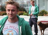 Pottering around! Tom Felton is in high spirits as he takes dog for a walk in Hollywood