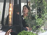 Infamous moment: Nigella Lawson and Charles Saatchi were allegedly rowing about whether her daughter Mimi should go to university in the lead up to this incident outside Scott's restaurant in Mayfair in June last year