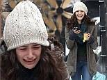 Emmy Rossum sheds tears as she films emotional scenes for Shameless but perks up to flash huge smile between takes