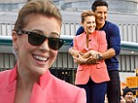 Alyssa Milano brushes off 'fat-shaming' incident as she shows off her slender figure while cosying up to Mario Lopez on Extra