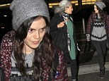 Cosy and casual: Rachel Bilson was all bundled up as she arrived at Los Angeles International Airport on Tuesday